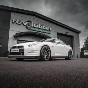 """This gorgeous white Nissan GTR is rolling on 20"""" Vossen VFS 1 alloys , with massive 12"""" wide rear Wheels clad in 305 x 30  rubber"""